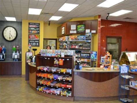 rooms to go payment center zones defined by material or wall color retail reno convenience store colors