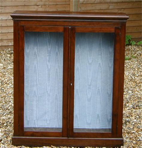 edwardian satin walnut bookcase with locking doors