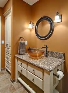 burnt orange paint against the granite this is what i want my bathroom to look like