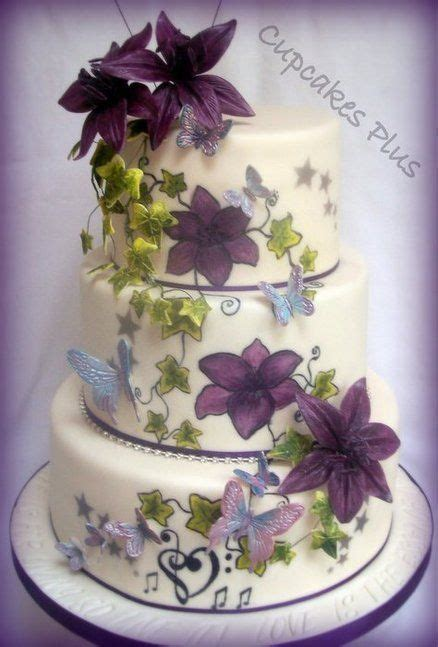Lily and butterfly wedding cake by cupcakes plus on Cakes