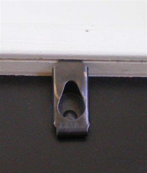 1 hole type samll picture hangers frame hardware steel hooker picture frame hardware yourpictureframes com blog