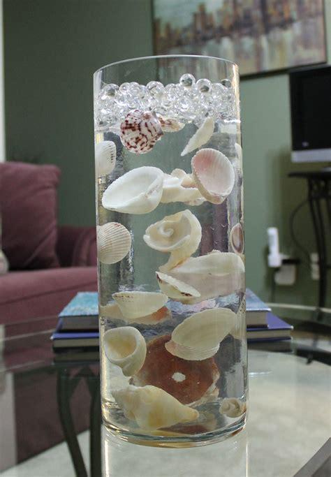 seashells suspended in clear water sooper cheep in