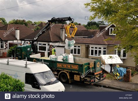 Travis Perkins Sheds by Travis Perkins Lorry Delivering Building Materials Stock