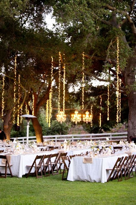 outdoor string lighting in trees wedding inspiration