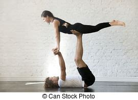 two people yoga positions images and stock photos. 1,088