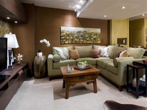 basement renovation transforms a cold space into a warm family room hgtv