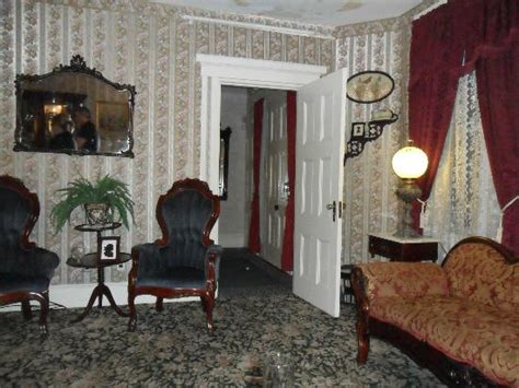 lizzie borden bed breakfast looks like a woman in a victorian dress in the upstairs