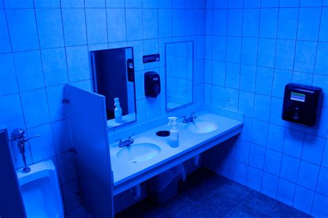 retailers are installing blue lights in bathrooms to stop