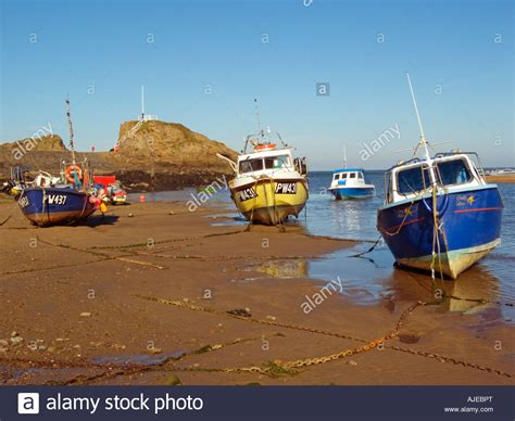 boat harbour rock fishing fishing boats at low water bude harbour chapel rock and
