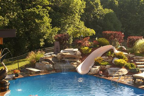 pool designs with slides exterior swimming pool with rock curved slide and
