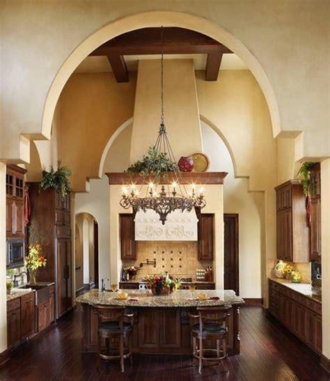 center island  adorable chandelier  tuscan kitchen
