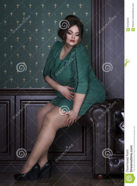 dressing professional for overweight women plus size fashion model in green evening dress fat woman