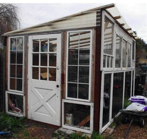 Greenhouse From Salvaged Windows Decor Glass Recycling For Greenhouse Designs Garden Houses Built With Salvaged Wood Windows