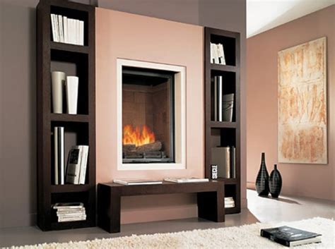 built in fireplace with wooden shelves biblio by