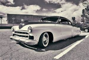 classic cars in black and white photos what are they