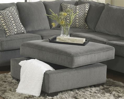loric sectional loric 12700 smoke grey sectional sofa living spaces ashley