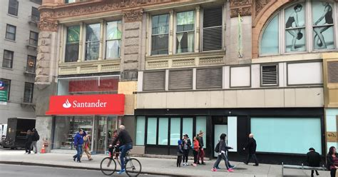 is santander bank open today ev grieve a santander bank branch opens today on 13th and