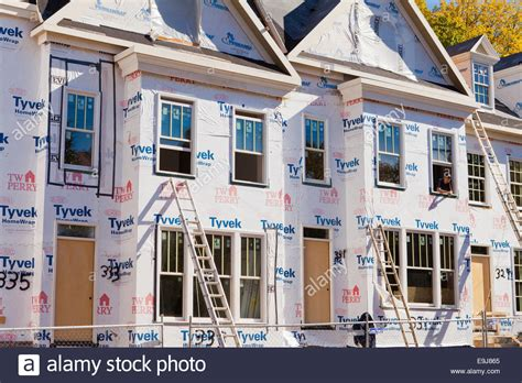 buy tyvek house wrap dupont tyvek house wrap applied on new home construction virginia stock photo