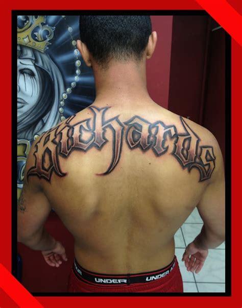 custom lettering across back tattoo done in waikiki