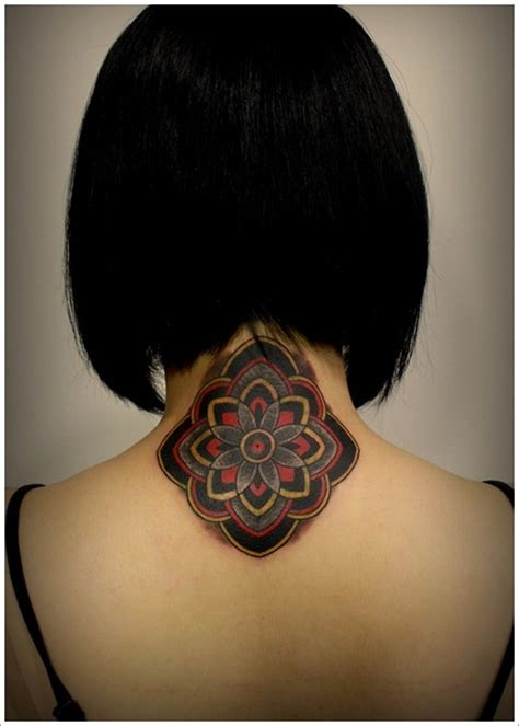 phenomenon small asian flower tattoo on upper back