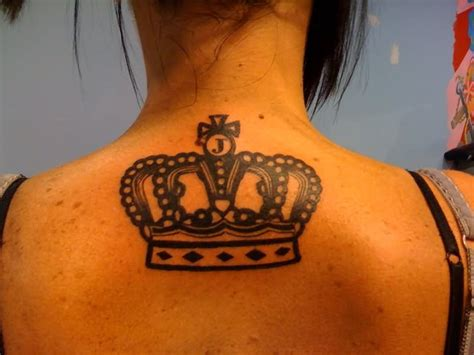 queen tattoo on back black queen crown tattoo on upper back