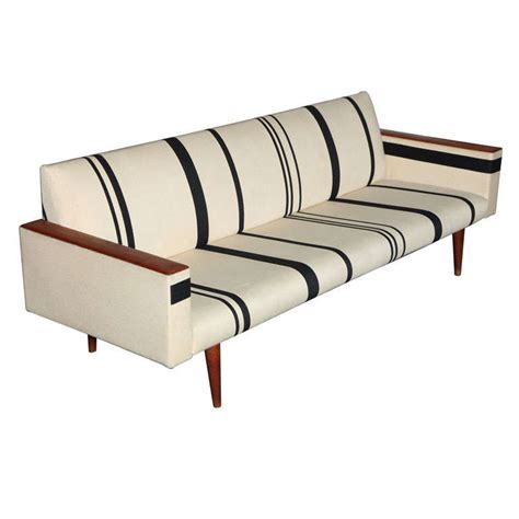 striped sofas black striped sofa with wooden armrests by illum wikkelso