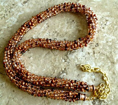 mixed copper white beaded kumihimo bracelet with gold 112 best beaded kumihimo necklaces images on pinterest