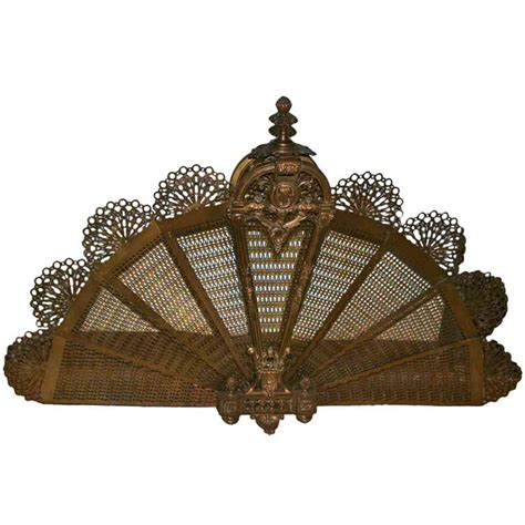 turn of the 19th centur y bronze fireplace screen fan form