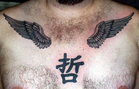wing tattoo under breast kanji symbol and wings tattoos on chest