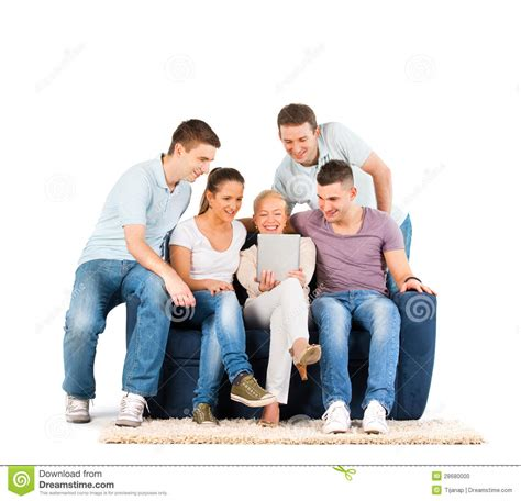 people having on the couch young people sitting on a sofa looking at a tablet stock
