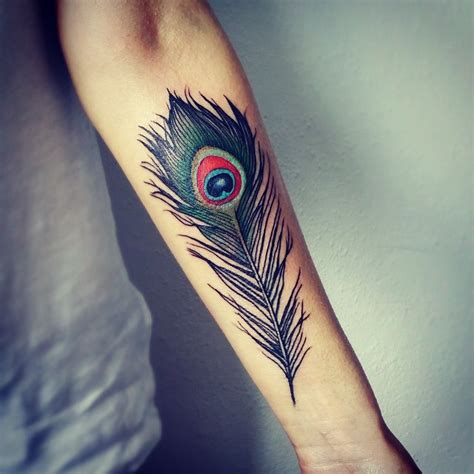 peacock feather tattoo upper arm colorful peacock feather tattoo on forearm