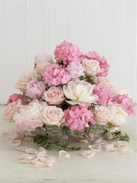 cupcake arrangements for bridal shower sweeten up your table with a floral cupcake centerpiece hgtv