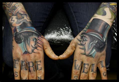 tattoo new school hand new school hand men hat tattoo by mike stocklings