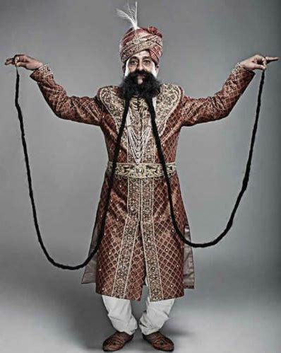 le pondremos un bigote hombre tiene el bigote mas largo del mundo planeta curioso