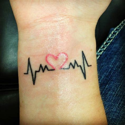 heart tattoo on wrist meaning heartbeat wrist designs ideas and meaning