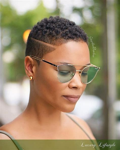 part shaved hairstyles for women tapered haircut with a disconnected side part twa black