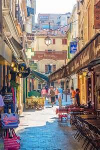 Rue meynadier is a narrow cobblestone pedestrian shopping street in