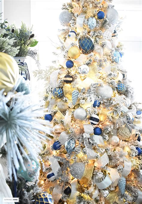 blue and gold christmas trees flocked tree with navy light blue silver and gold ornaments