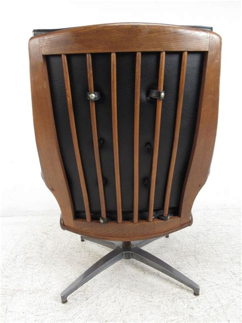 swivel chair with ottoman heywood wakefield swivel lounge chair with ottoman at 1stdibs