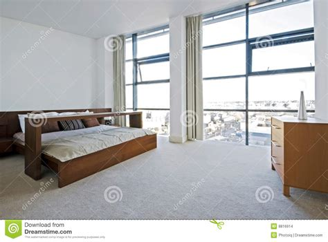 floor to ceiling bedroom furniture luxury bedroom with floor to ceiling windows stock images
