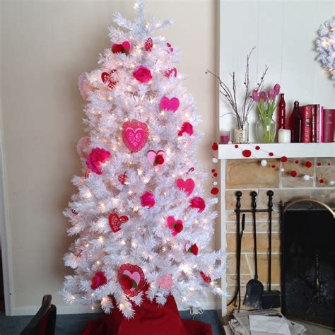 decorating a pink christmas tree pink ornament white tree festival collections