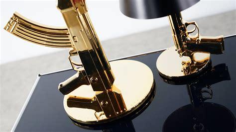 philippe starck philippe starck gun l for flos bedside gun table gun