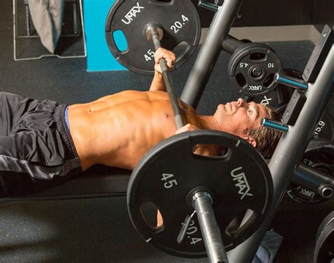 paused bench press 2 tricks to smash through your chest training plateau