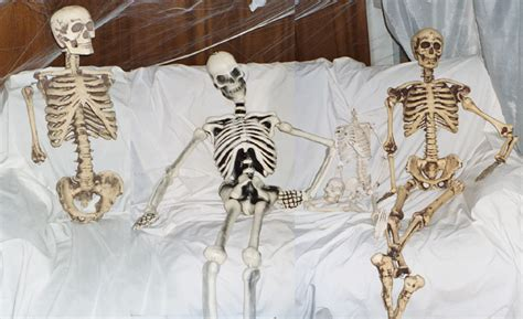 skeleton couch hollyween the funeral parlor