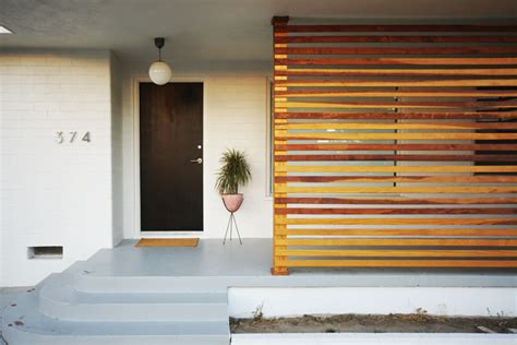modern wood slat wall brick house