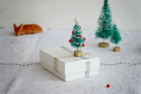 miniature christmas tree ornaments lines across