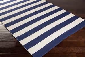 newport stripe cotton rug in navy by surya