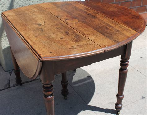 Early 19th Century Round Rustic Drop Leaf Table at 1stdibs