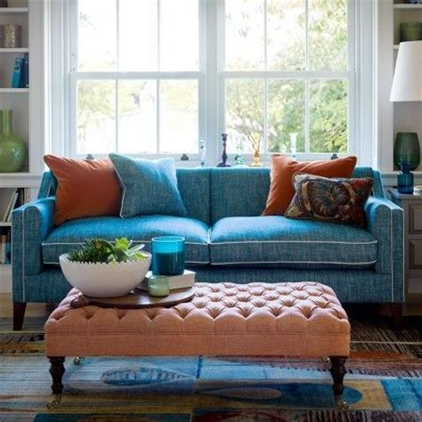 blue sofa with white piping tufted ottoman as coffee