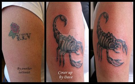cover up of name scorpion cover up tattoo by